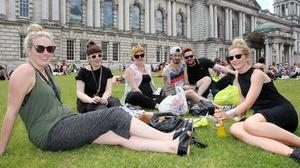 Northern Ireland- 9th July 2013 Mandatory Credit - Photo-Jonathan Porter/Presseye.    Good weather and sunshine continues across Northern Ireland as temperatures reach a 30-year- high.  Left to right.  Sandra, Claire, Alison, Rich, Benjamin, Kelly take advantage from of their lunch hour from Urban outfitters to relax grounds of the City Hall in Belfast.