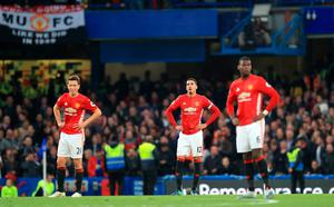 "Manchester United's Ander Herrera, Chris Smalling and Paul Pogba look dejected after their side concede their third goal during the Premier League match at Stamford Bridge, London. PRESS ASSOCIATION Photo. Picture date: Sunday October 23, 2016. See PA story SOCCER Chelsea. Photo credit should read: John Walton/PA Wire. RESTRICTIONS: EDITORIAL USE ONLY No use with unauthorised audio, video, data, fixture lists, club/league logos or ""live"" services. Online in-match use limited to 75 images, no video emulation. No use in betting, games or single club/league/player publications."