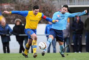 Ards Rangers' Alan Rees (right) battles with Drumaness Mills' Conor Walsh, December 28, 2013