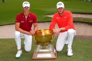 Thomas Detry and Thomas Pieters of Belgium pose with the World Cup trophy
