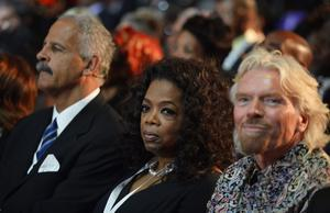 British entrepreneur Richard Branson, right and television host Oprah Winfrey attend the funeral service for former South African President Nelson Mandela in Qunu, South Africa, Sunday, Dec. 15, 2013. (AP Photo/Odd Andersen, Pool)
