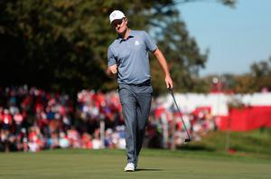 Europe's Justin Rose celebrates his putt on the 8th to win the hole, during the singles matches on day three of the 41st Ryder Cup at Hazeltine National Golf Club in Chaska, Minnesota, USA. David Davies/PA Wire.
