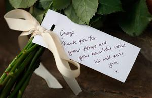 Floral tributes are left outside the Goring house of George Michael in Oxfordshire as the pop superstar has died at the age of 53 from suspected heart failure.