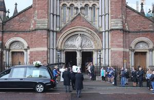 Noah Donohoe's coffin is carried into St Patrick's Church in Belfast (Niall Carson/PA)