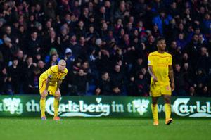 Liverpool's Martin Skrtel and Raheem Sterling stand dejected after conceding their second goal of the game with team-mates during the Barclays Premier League match at Selhurst Park, London. Adam Davy/PA Wire.