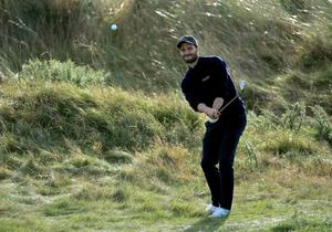 Jamie Dornan plays his third shot to the third hole during the first round of the 2014 Alfred Dunhill Links Championship  (Photo by David Cannon/Getty Images)