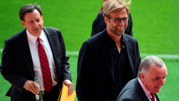 Liverpool Chairman Tom Werner (L), Liverpool's German manager Jurgen Klopp (C) and Liverpool chief executive Ian Ayre react as they arrive for the ceremonial opening of Liverpool Football Club's new main stand, at Anfield stadium in Liverpool, north-west England, on September 9, 2016.  / AFP PHOTO / PAUL ELLISPAUL ELLIS/AFP/Getty Images