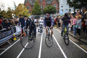 Members of the public take part in the slow bike race during the culture night in Belfast city centre.  Picture by Peter Morrison