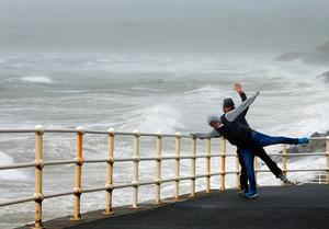 "People battle the waves and high wind at Lahinch in County Clare on the West Coast of Ireland as Hurricane Ophelia hits the UK and Ireland with gusts of up to 80mph. PRESS ASSOCIATION Photo. Picture date: Monday October 16, 2017. The tropical storm has made its way across the Atlantic and Ophelia's remnants reached home shores on Monday, resulting in ""exceptional"" weather - exactly 30 years after the Great Storm of 1987 killed 18 people. See PA story WEATHER Ophelia. Photo credit should read: Niall Carson/PA Wire"