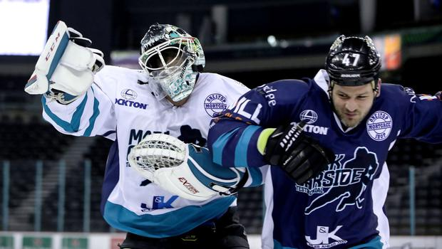 Belfast Giants netminder Andrew Dickson and head coach Adam Keefe collide during the speed race at Mark Garside's Testimonial at the SSE Arena (William Cherry/PressEye)