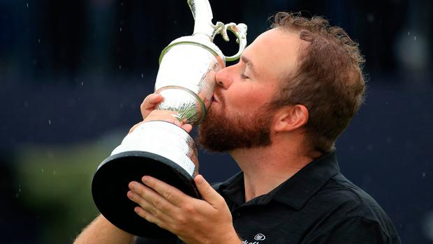 Open Champions Shane Lowry gets his hands on the Claret Jug