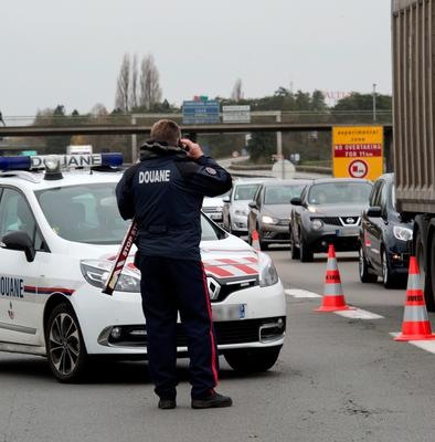 Police and customs officers control vehicles on November 14, 2015 at the France-Belgium border at Neuville-en-Ferrain, following terrorist attacks in Paris resulting in the death of at least 128 individuals and declaration of a state of emergency. AFP PHOTO / DENIS CHARLETDENIS CHARLET/AFP/Getty Images
