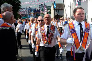 Orangemen take part in the annual July 12 parade in Belfast, on July 12, 2017. July 12 is the main marching day in the Orange Order calendar. The parades mark the Protestant commemoration of the 327th anniversary of King William III's victory at the Battle of the Boyne in 1690. / AFP PHOTO / Paul FAITHPAUL FAITH/AFP/Getty Images