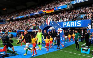 PARIS, FRANCE - JUNE 21: Northern Ireland and Germany make their way onto the pitch before the UEFA EURO 2016 Group C match between Northern Ireland and Germany at Parc des Princes on June 21, 2016 in Paris, France. (Photo by Charles McQuillan/Getty Images)