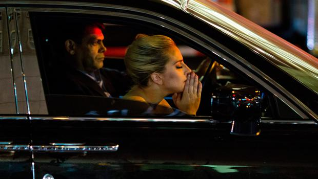 ady Gaga sits in her car after staging a protest against Republican presidential nominee Donald Trump outside Trump Tower in New York City after midnight on election day November 9, 2016. AFP/Getty Images