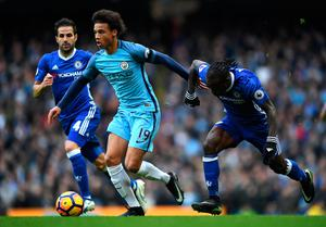 MANCHESTER, ENGLAND - DECEMBER 03:  Leroy Sane of Manchester City and Victor Moses of Chelsea compete for the ball during the Premier League match between Manchester City and Chelsea at Etihad Stadium on December 3, 2016 in Manchester, England.  (Photo by Laurence Griffiths/Getty Images)