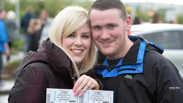 Pacemaker Press 09/05/2018 Ed Sheeran fans  Carolyn  and Kevin Lenaghan (who got engaged at a previous Ed Sheeran Concert in London)   at Boucher Road in Belfast on Wednesday evening,   with  around  42,000 people expected at Boucher playing fields for the Ed  Sheeran Concert. Photo  Pacemaker Press