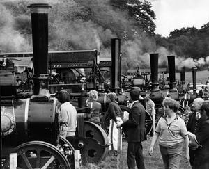 Puffing their way into the centre attraction is the line-up of traction engines and steam engines at the annual steam engine rally at Shane's Castle, near Antrim.  24/7/1975