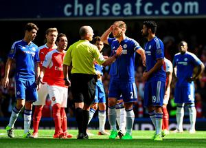 LONDON, ENGLAND - SEPTEMBER 19:  Referee Mike Dean talks with Diego Costa of Chelsea during the Barclays Premier League match between Chelsea and Arsenal at Stamford Bridge on September 19, 2015 in London, United Kingdom.  (Photo by Ross Kinnaird/Getty Images)