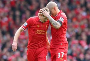 Martin Skrtel of Liverpool celebrates scoring the second goal with team-mate Steven Gerrard (L) during the Barclays Premier League match between Liverpool and Manchester City at Anfield on April 13, 2014 in Liverpool, England.  (Photo by Alex Livesey/Getty Images)