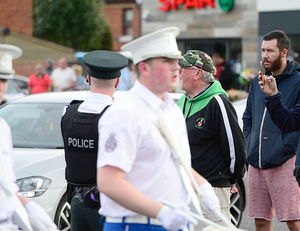 """The Orange Order parade through Ardoyne passed off peacefully in Belfast, Northern Ireland. Damien """"Dee"""" Fennell, a spokesman for the Greater Ardoyne Residents' pictured during the parade. Picture By: Arthur Allison/Pacemaker Press."""