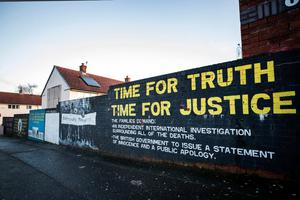 A mural on a wall in the Ballymurphy area of west Belfast where shooting of 10 civilians took place in 1971. Credit: Liam McBurney/PA Wire