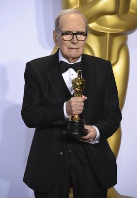 Ennio Morricone with the award for best original score for The Hateful Eight at the Oscars (Jordan Strauss/Invision/AP)