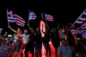 Supporters of the No vote celebrate after the results of the referendum at Syntagma square in Athens, Sunday, July 5, 2015. Greeks overwhelmingly rejected creditors demands for more austerity in return for rescue loans in a critical referendum Sunday, backing Prime Minister Alexis Tsipras, who insisted the vote would give him a stronger hand to reach a better deal. (AP Photo/Petr David Josek)