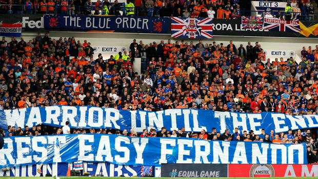 Rangers fans with a banner in memory of former player Fernando Ricksen before the UEFA Europa League Group G match at Ibrox Stadium, Glasgow. PA Photo. Picture date: Thursday September 19, 2019. See PA story SOCCER Rangers. Photo credit should read: Andrew Milligan/PA Wire