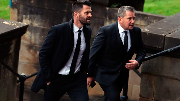 Steven Thompson and Billy Dodds (right) attend the funeral of former Rangers footballer Fernando Ricksen at Wellington Church, Glasgow. PA Photo. Picture date: Wednesday September 25, 2019. The former Holland international died aged 43 a week ago, six years after being diagnosed with motor neurone disease. Ricksen played more than 250 times for the Light Blues after joining from AZ Alkmaar in 2000, winning two league titles during his time in Glasgow. See PA story SOCCER Ricksen. Photo credit should read: Andrew Milligan/PA Wire.