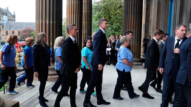 Peter Lovenkrands and Tore Andre Flo attend the funeral of former Rangers footballer Fernando Ricksen at Wellington Church, Glasgow. PA Photo. Picture date: Wednesday September 25, 2019. The former Holland international died aged 43 a week ago, six years after being diagnosed with motor neurone disease. Ricksen played more than 250 times for the Light Blues after joining from AZ Alkmaar in 2000, winning two league titles during his time in Glasgow. See PA story SOCCER Ricksen. Photo credit should read: Andrew Milligan/PA Wire.