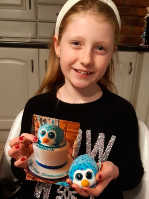 Charlie's sister Nancy with a cake made to look like Gus, Charlie's favourite soft toy
