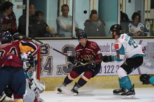 The Giants tussle with the Guildford Flames. Credit:John Uwins