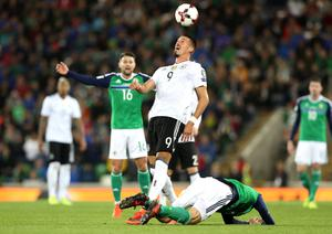 Press Eye - Belfast -  Northern Ireland - 05th October 2017 - Photo by William Cherry/Presseye  Northern Ireland's Conor McLaughlin with Germany's Sandro Wagner during Thursdays World Cup Qualifier at the National Football Stadium at Windsor Park, Belfast. Photo by William Cherry/Presseye