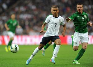 LONDON, ENGLAND - MAY 29:  Theo Walcott of England and James McCarthy of the Republic of Ireland watch the ball during the International Friendly match between England and the Republic of Ireland at Wembley Stadium on May 29, 2013 in London, England.  (Photo by Shaun Botterill/Getty Images)