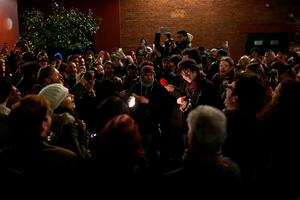 LONDON, ENGLAND - JANUARY 11: People perform David Bowie songs as they celebrate his life at a gathering in Brixton on January 11, 2016 in London, England. British music and fashion icon David Bowie died earlier today at the age of 69 after a battle with cancer. (Photo by Carl Court/Getty Images)