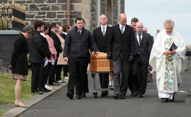 PACEMAKER,BELFAST,7/5/2020: The coffin of former SDLP MLA John Dallat leaves St Mary's church outside Kilrea in Co. Derry for burial in the church graveyard. PICTURE BY STEPHEN DAVISON