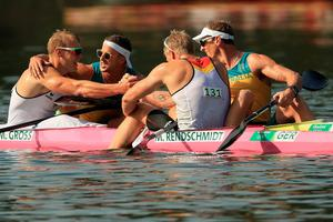 RIO DE JANEIRO, BRAZIL - AUGUST 18:  Max Rendschmidt and Marcus Gross of Germany react with Ken Wallace and Lachlan Tame of Australia after winning gold and bronze respectively in the Men's Kayak Double 1000m event at the Lagoa Stadium on Day 13 of the 2016 Rio Olympic Games on August 18, 2016 in Rio de Janeiro, Brazil.  (Photo by Mike Ehrmann/Getty Images) *** BESTPIX ***