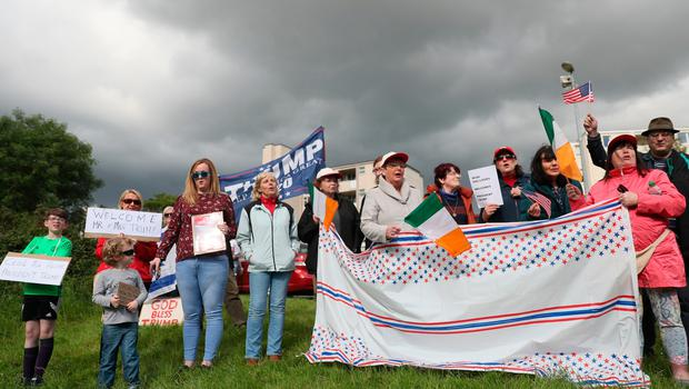 Supporters of US President Donald Trump gather near to Shannon Airport following his arrival for his visit to the Republic of  Ireland. PRESS ASSOCIATION Photo. Picture date: Wednesday June 5, 2019. See PA story IRISH Trump. Photo credit should read: Brian Lawless/PA Wire