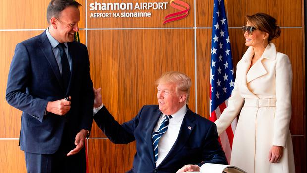 SHANNON, IRELAND - JUNE 05: US President Donald Trump signs the visitors book as Taoiseach Leo Varadkar (L) and First Lady Melania Trump (R) watch on at Shannon Airport on June 5, 2019 in Shannon, Ireland. After visiting the UK for the D-Day 75th anniversary, US President Donald Trump will visit Ireland to meet with Taoiseach Leo Varadkar before travelling to the Trump International Golf Links resort in Doonbeg.(Photo by Pool/Getty Images)