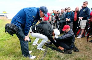 Spectator sits down with Denmark's Lucas Bjerregaard ball under him during day two of The Open Championship 2019 at Royal Portrush Golf Club. PRESS ASSOCIATION Photo. Picture date: Friday July 19, 2019. See PA story GOLF Open. Photo credit should read: Richard Sellers/PA Wire. RESTRICTIONS: Editorial use only. No commercial use. Still image use only. The Open Championship logo and clear link to The Open website (TheOpen.com) to be included on website publishing.