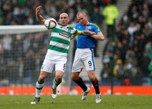 Rangers' 	Kenny Miller and Celtic's Scott Brown (left) battle for the ball during the William Hill Scottish Cup semi-final match at Hampden Park, Glasgow. PRESS ASSOCIATION Photo. Picture date: Sunday April 17, 2016. See PA story SOCCER Rangers. Photo credit should read: Danny Lawson/PA Wire. EDITORIAL USE ONLY