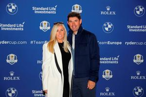 LONDON, ENGLAND - SEPTEMBER 26:  Vice-Captain of Europe, Padraig Harrington poses with his wife Caroline Harrington as he departs the Hilton London Heathrow Airport Terminal 5 ahead of the 2016 Ryder Cup on September 26, 2016 in London, England.  (Photo by Warren Little/Getty Images)