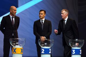 COSTA DO SAUIPE, BRAZIL - DECEMBER 06:  Draw assistants Sir Geoff Hurst walks past Zinedine Zidane and Fabio Cannavaro during the Final Draw for the 2014 FIFA World Cup Brazil at Costa do Sauipe Resort on December 6, 2013 in Costa do Sauipe, Bahia, Brazil.  (Photo by Clive Mason/Getty Images)