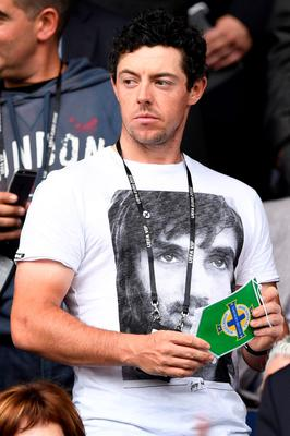 Golf star Rory McIlroy is pictured ahead of the Euro 2016 group C football match between Northern Ireland and Germany at the Parc des Princes stadium in Paris on June 21, 2016. / AFP PHOTO / LIONEL BONAVENTURELIONEL BONAVENTURE/AFP/Getty Images
