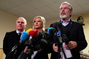Sinn Fein President Gerry Adams (R) and Northern Ireland Leader, Michelle O'Neill (C) speak at a press conference in the Bogside neighbourhood of Derry on March 21, 2017. AFP/Getty Images