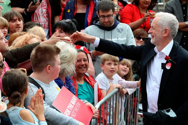 WATFORD, UNITED KINGDOM - JUNE 07:  Jeremy Corbyn, Leader of the Labour Party greets supporters during a campaign rally at the Parade on June 7, 2017 in Watford, United Kingdom. The Labour leader is holding six rallies across Scotland, England and Wales today on the final day before polling day in the General Election.  (Photo by Matt Cardy/Getty Images)