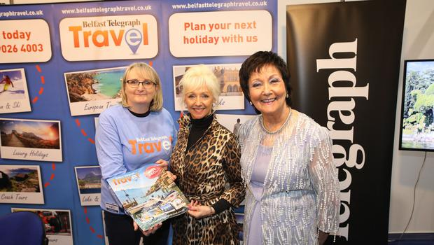 Debbie Mc Gee visits the Belfast Telegraph stand from left, Joanne Uprichard, Margeting Manager and Mourneen Ledwith Sales Director Holiday World Show at the TEC centre for the Belfast Telegraph Holiday World Show.  Photo by Peter Morrison
