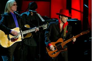 (FILES) This file photo taken on March 15, 2004 shows, Inductee Prince performing a song of George Harrison along with Tom Petty after the late Beatle was inducted during the 19th Annual Rock and Roll Hall of Fame Induction Ceremony in New York City.  Pop icon Prince -- whose pioneering brand of danceable funk made him one of music's most influential figures -- died on April 21, 2016 at his compound in Minnesota. He was 57. / AFP PHOTO / TIMOTHY A. CLARYTIMOTHY A. CLARY/AFP/Getty Images