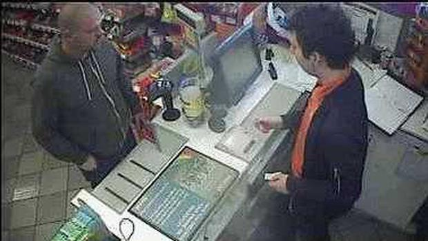 Police released CCTV of Thomas O'Hara and Darren McAllister purchasing the lighter to burn the car. Shown is Darren McAllister.